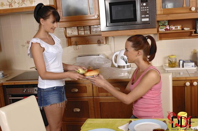 Man fucks two sweet lesbians in the kitchen 1 photo