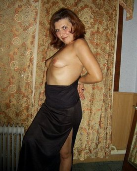 Good madam in a black dress was bared in her room