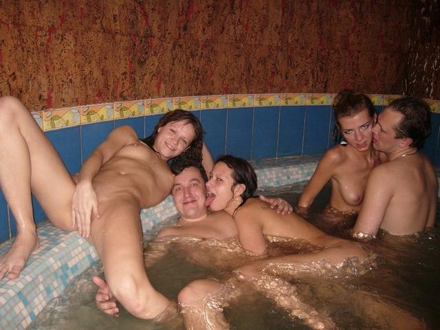 Young sluts surrounded by a vast amount of erect dicks 19 photo