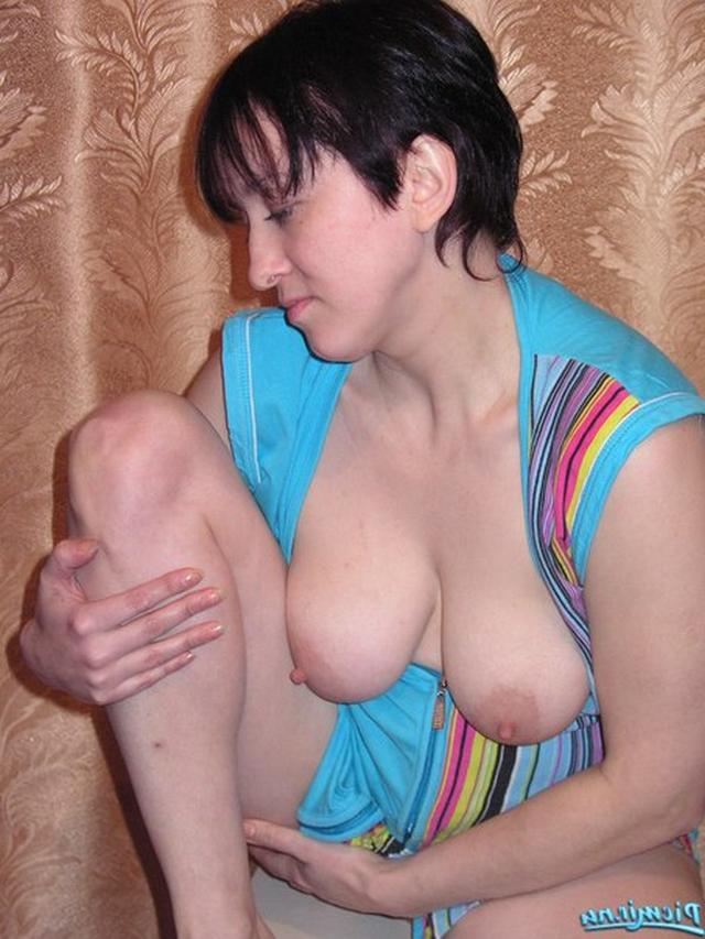 Titted woman in dressing gown rubs her pussy 6 photo