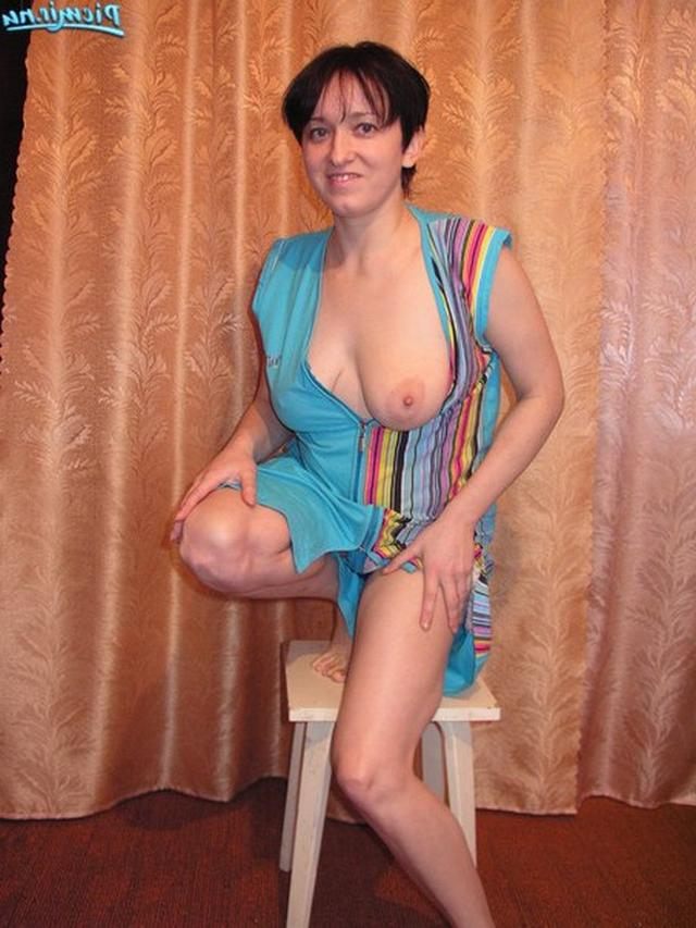 Titted woman in dressing gown rubs her pussy 13 photo