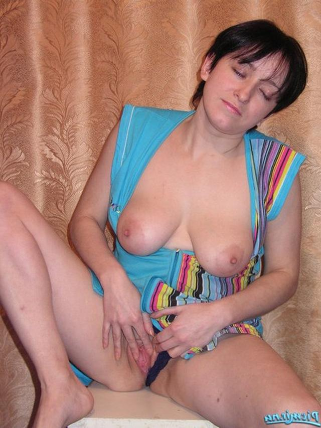 Titted woman in dressing gown rubs her pussy 8 photo