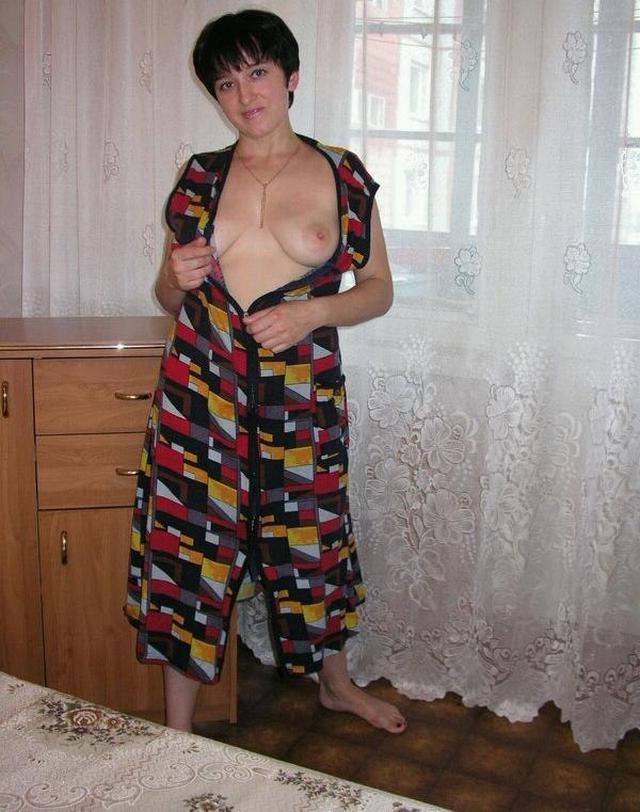 Housewife showed that she had beneath light dressing gown 3 photo