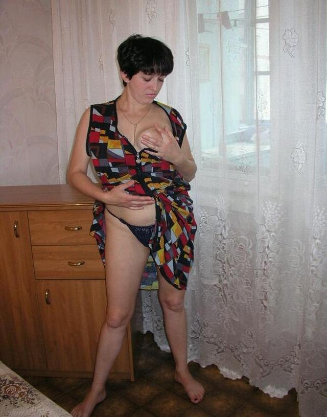 Housewife showed that she had beneath light dressing gown 1 photo