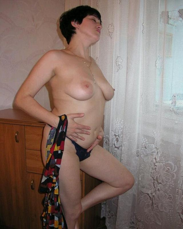 Housewife showed that she had beneath light dressing gown 13 photo