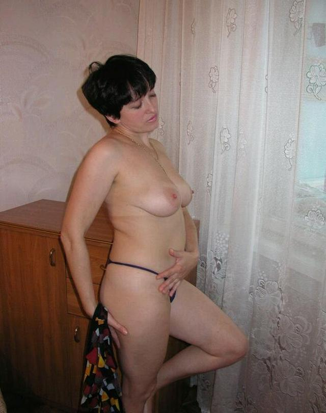 Housewife showed that she had beneath light dressing gown 12 photo