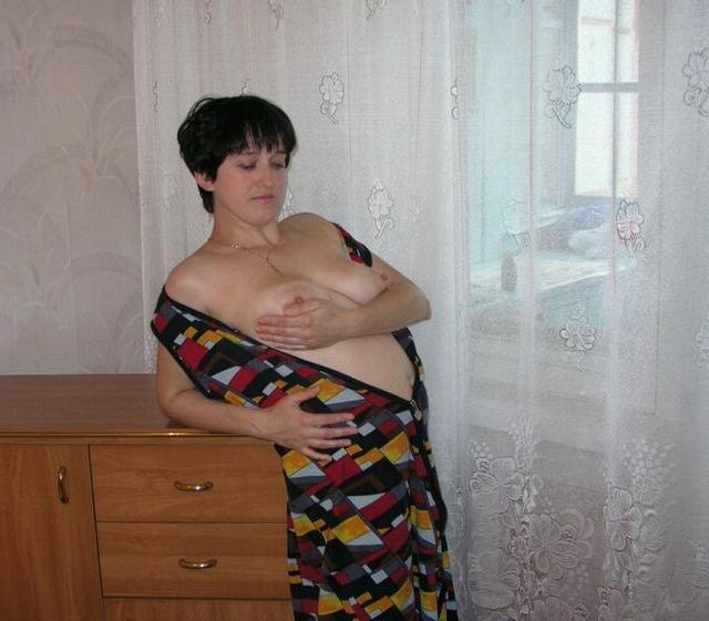 Housewife showed that she had beneath light dressing gown 11 photo