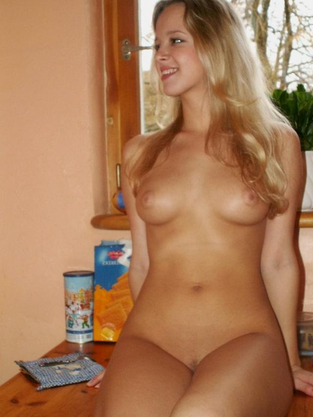 Sexy blonde poses absolutely naked on the kitchen 16 photo