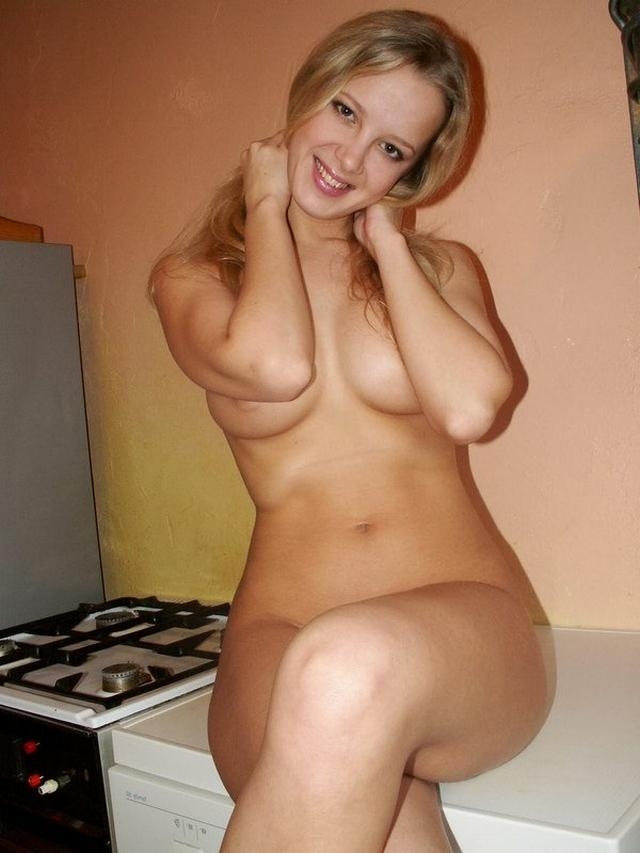 Sexy blonde poses absolutely naked on the kitchen 12 photo
