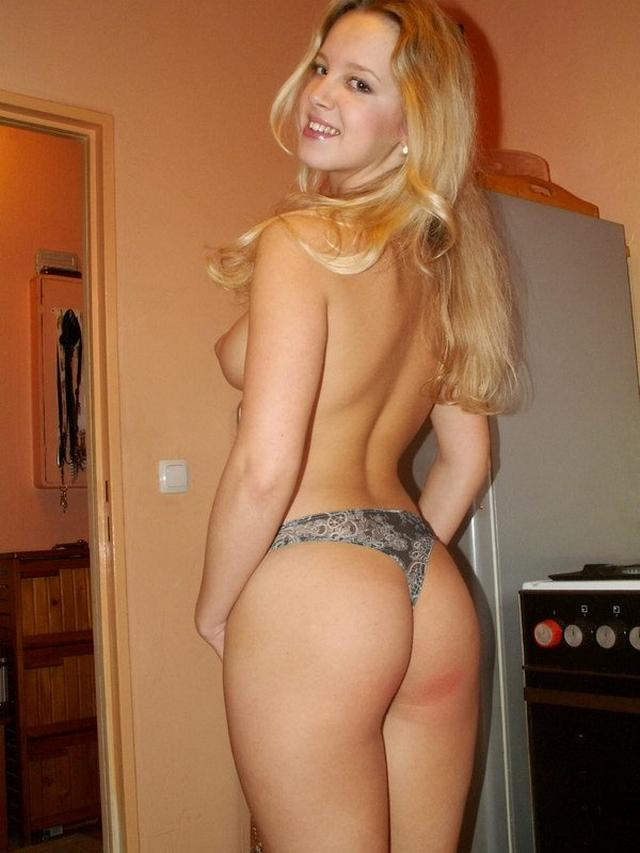 Sexy blonde poses absolutely naked on the kitchen 3 photo