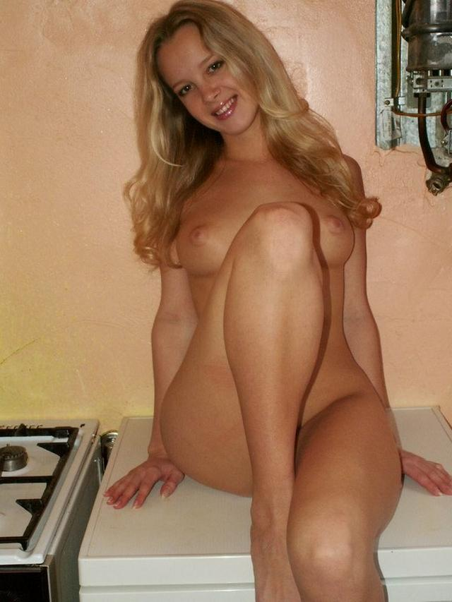 Sexy blonde poses absolutely naked on the kitchen 20 photo