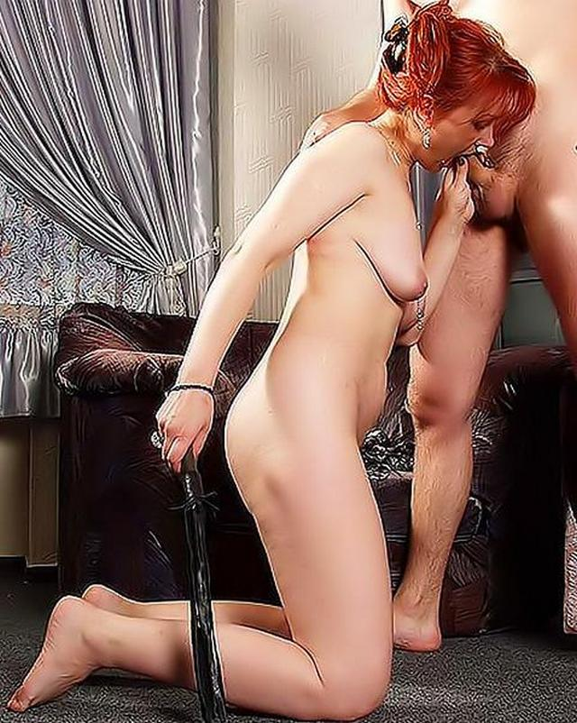 Red-haired beast pleasure for her slave 12 photo