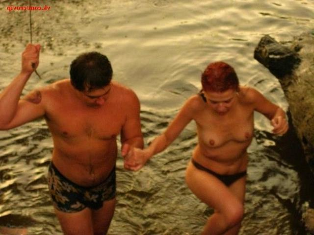 Slender nudists bathing naked on the beach 3 photo