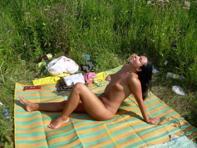 Half-naked brunette shows her beauty 4 photo