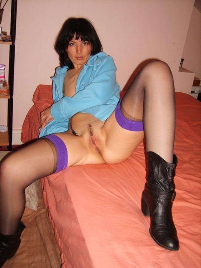 Adult brunette shows her acting pussy in all positions 23 photo
