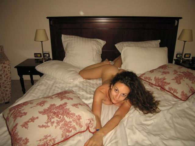 Naked brunette with nice huge tits on a wide bed 7 photo