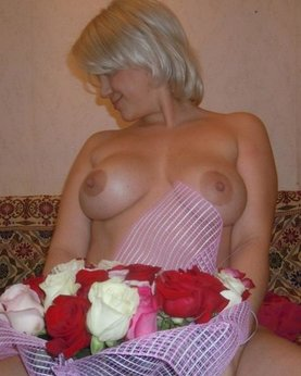 Playful blonde madly in love with flowers and romantic sex