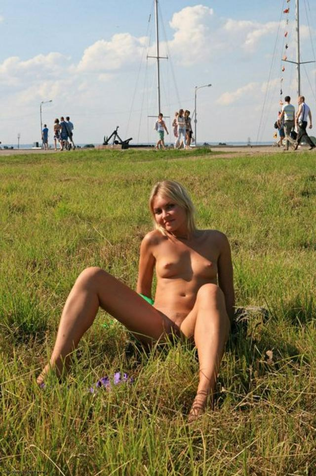 Blonde exhibitionist shows her shaved pussy outdoors 5 photo