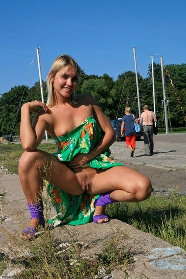 Blonde exhibitionist shows her shaved pussy outdoors 50 photo