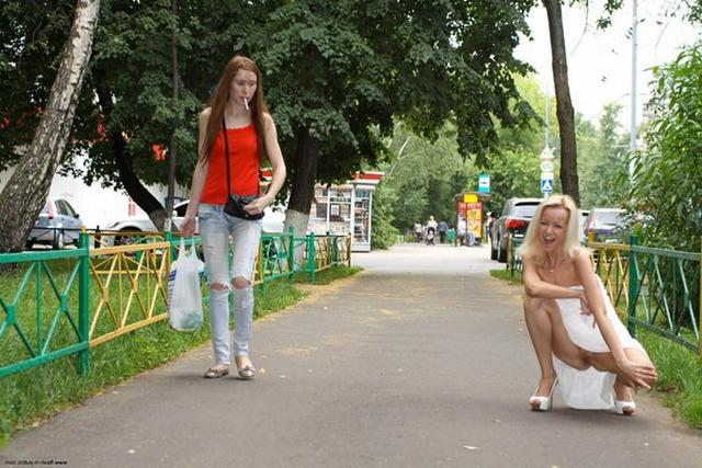 Skinny blonde shows shaved pussy in public places 20 photo
