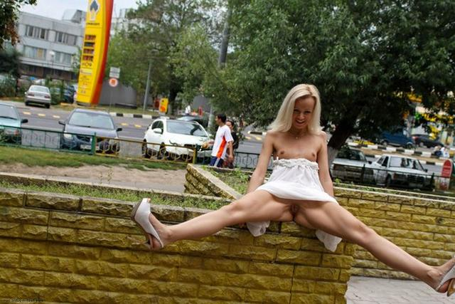 Skinny blonde shows shaved pussy in public places 24 photo