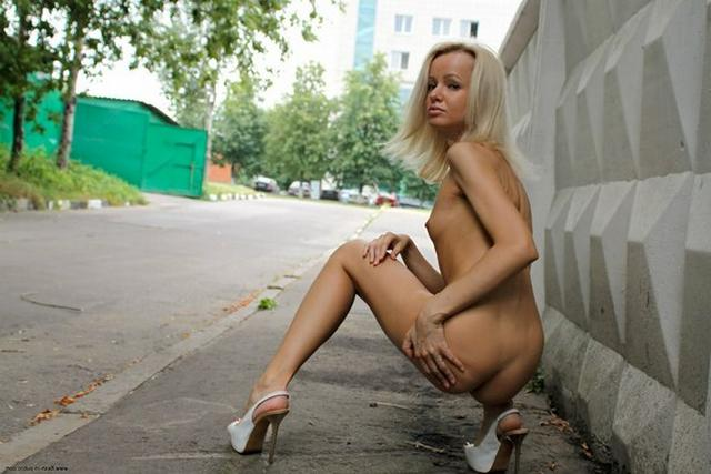 Skinny blonde shows shaved pussy in public places 28 photo