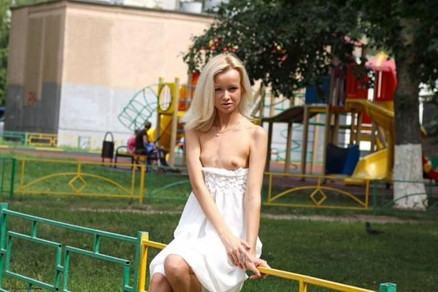 Skinny blonde shows shaved pussy in public places 2 photo