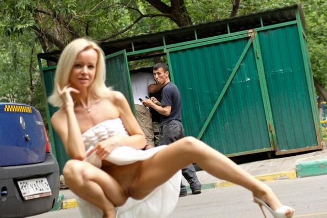 Skinny blonde shows shaved pussy in public places 15 photo