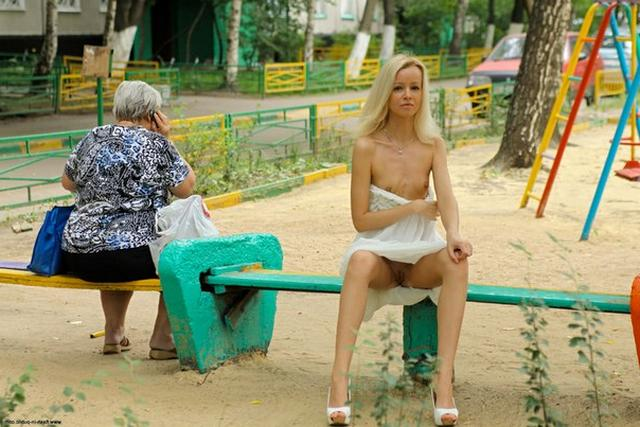 Skinny blonde shows shaved pussy in public places 12 photo