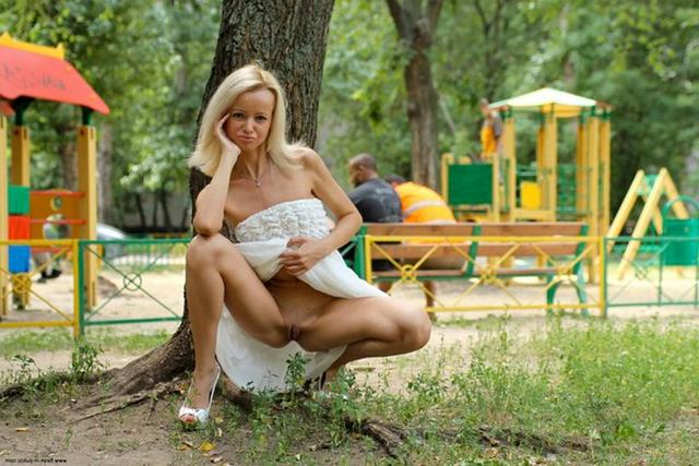 Skinny blonde shows shaved pussy in public places 4 photo