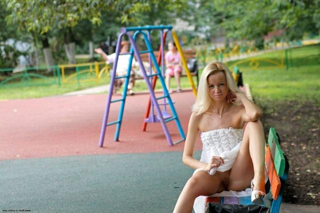 Skinny blonde shows shaved pussy in public places 6 photo