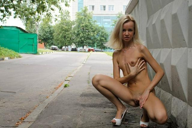 Skinny blonde shows shaved pussy in public places 27 photo