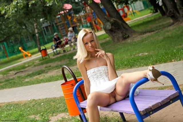Skinny blonde shows shaved pussy in public places 17 photo