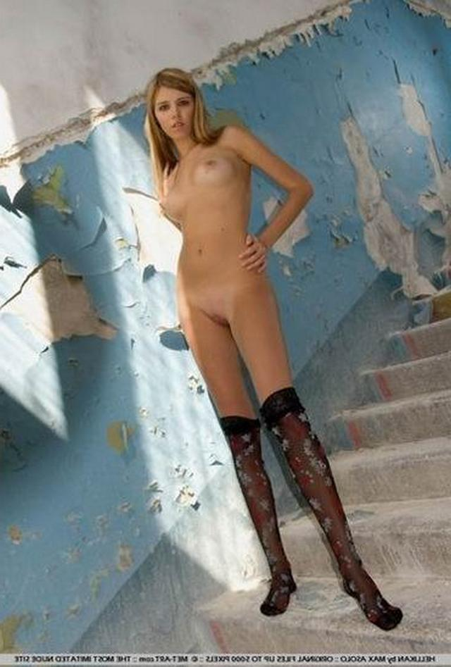 Long-legged whores posing in stairwell 7 photo
