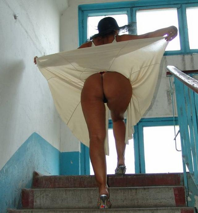 Long-legged whores posing in stairwell 9 photo