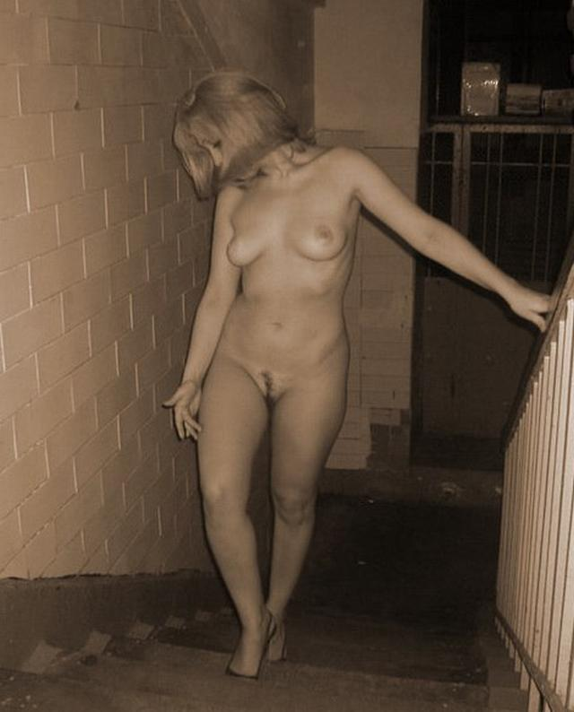 Long-legged whores posing in stairwell 8 photo
