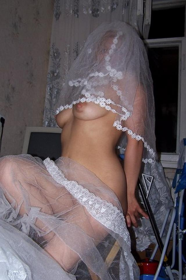 Cute bride in a wedding dress without panties 1 photo
