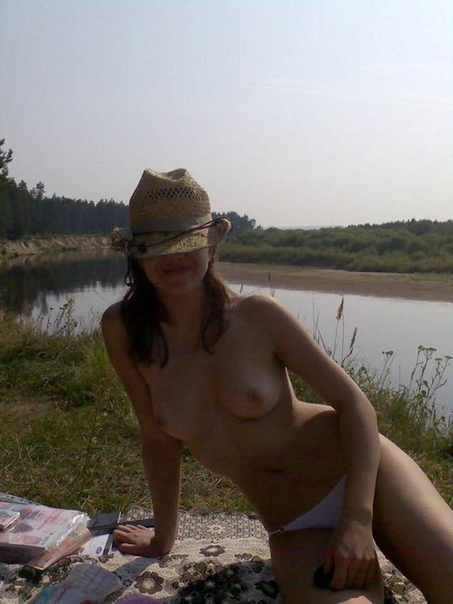 Cute girl sunbathes topless outdoors 7 photo