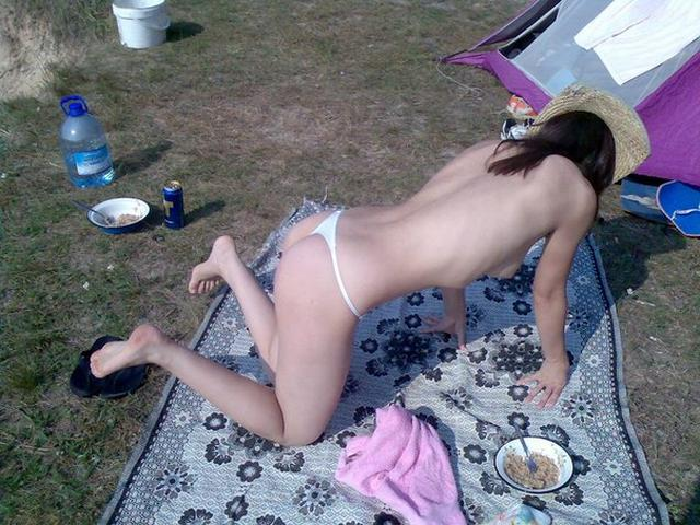 Cute girl sunbathes topless outdoors 8 photo