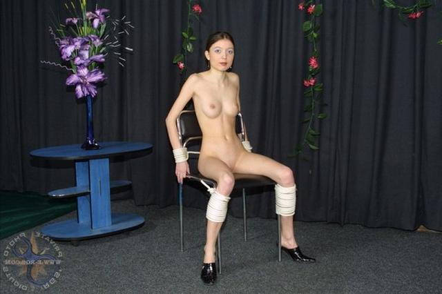Man tied the slim girl to chair and fucked in all holes 1 photo