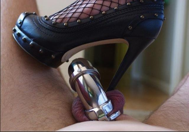 Manacled male dicks in the hands of mistresses 14 photo