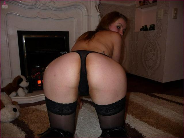 Red-haired slut in pantyhose show her gently pussy 21 photo