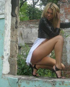 Cute blonde with nice body posing in some ruins