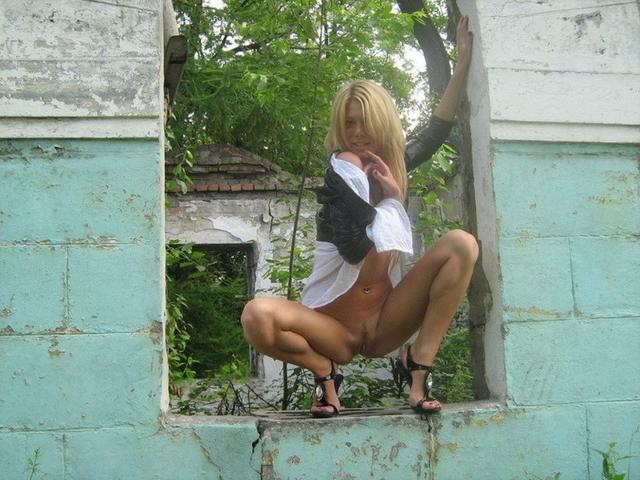 Cute blonde with nice body posing in some ruins 12 photo
