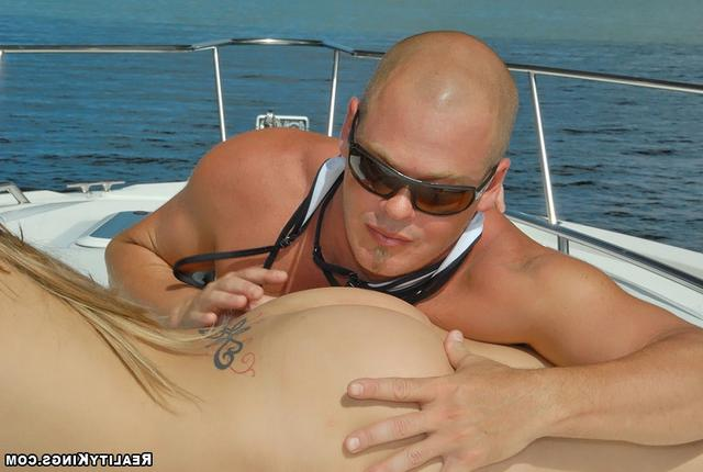 Bald guy fucked sporty girl on the high seas 14 photo