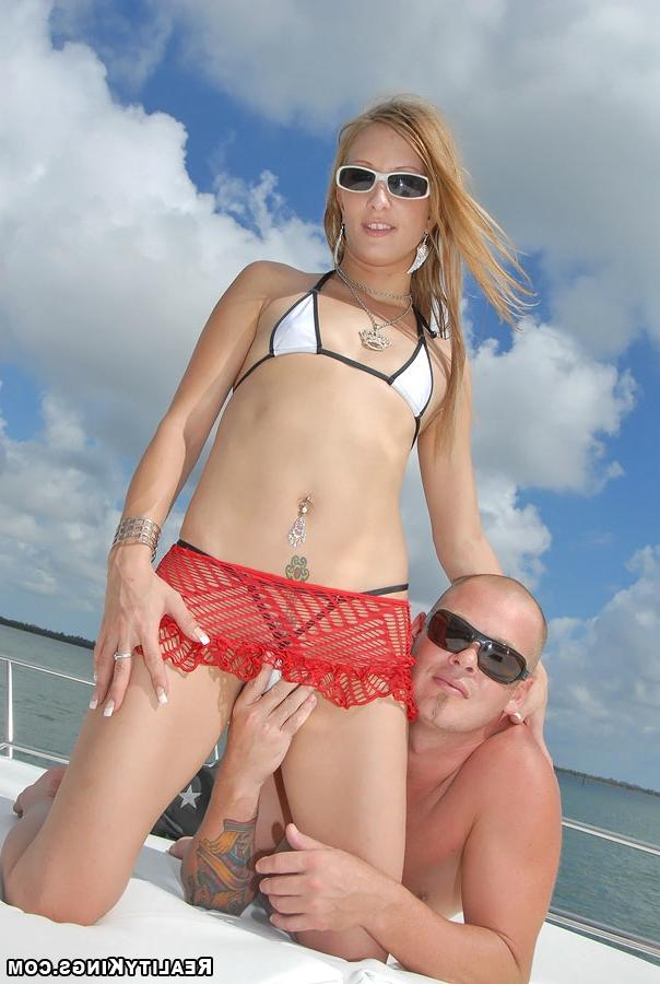 Bald guy fucked sporty girl on the high seas 8 photo