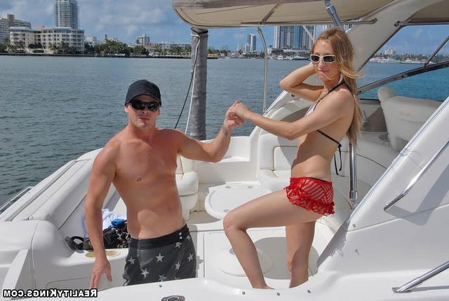 Bald guy fucked sporty girl on the high seas 5 photo