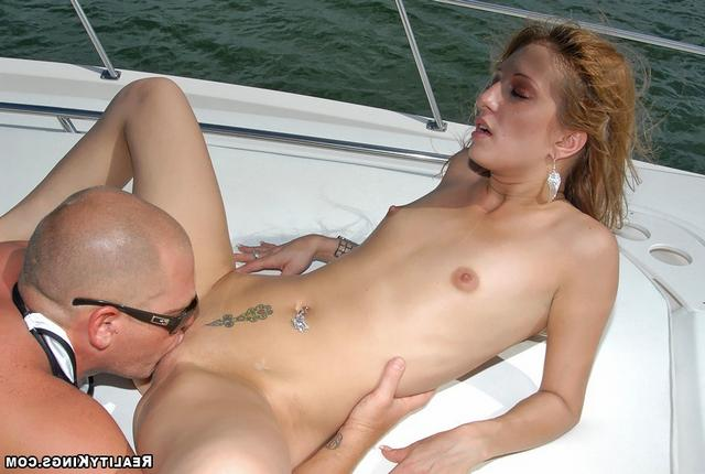 Bald guy fucked sporty girl on the high seas 13 photo