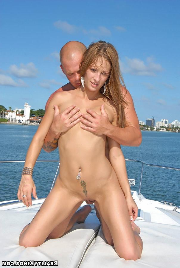 Bald guy fucked sporty girl on the high seas 19 photo