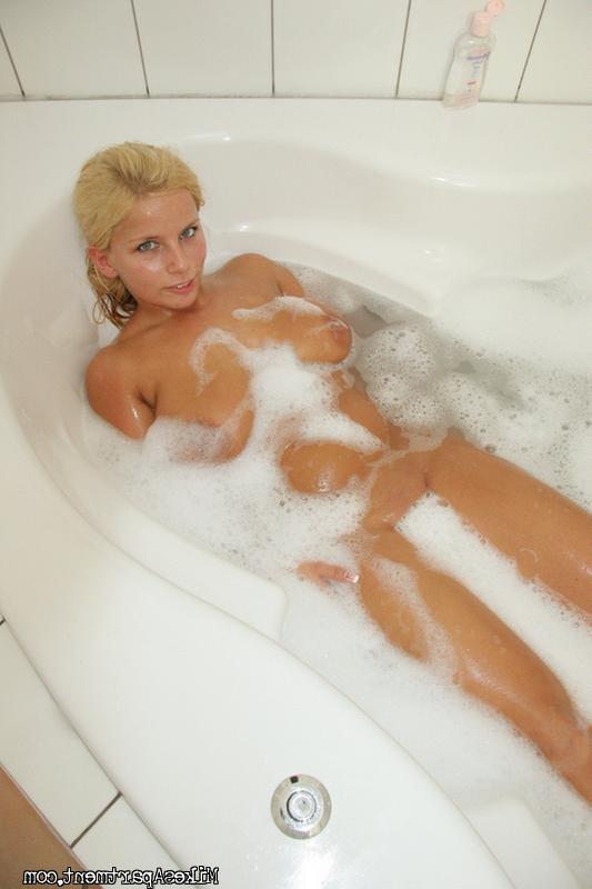 Lucy sucks big dick in bathroom 2 photo